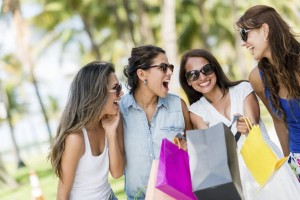 Group of girls having fun shopping for the summer
