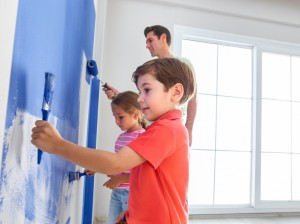 Father, son and Daugther painting wall
